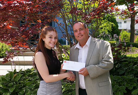 2017 President Jim Smith hands in the scholarship cheque to Felicidy Hocking