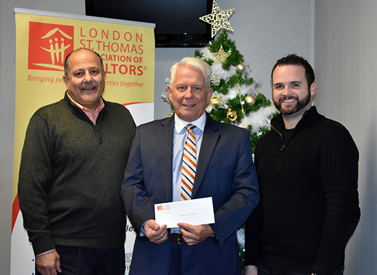 Cheque Presentation to Hockey Helps the Homeless